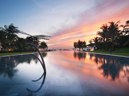 The swimming pool at or near Pullman Danang Beach Resort