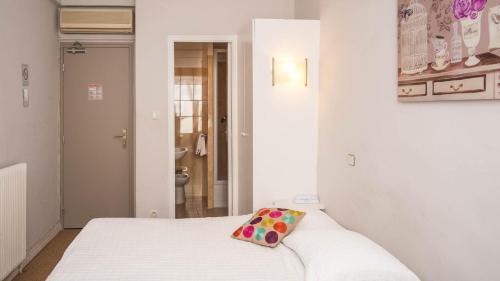 Un ou plusieurs lits dans un hébergement de l'établissement Hotel Solara