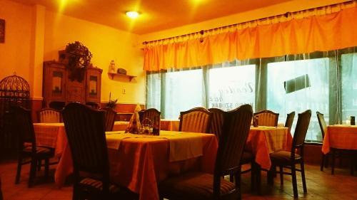 A restaurant or other place to eat at Kilátó Vendégház és Étterem