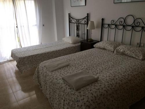 A bed or beds in a room at Apartamento Mateos 50 por ciento dcto directo