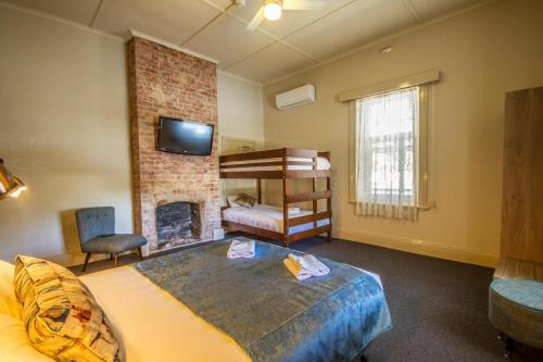 A bunk bed or bunk beds in a room at Pretoria Hotel