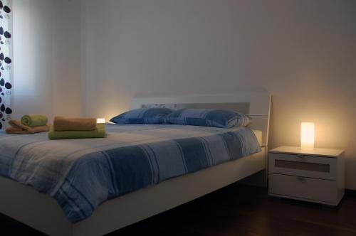 A bed or beds in a room at Apartment Spanjol