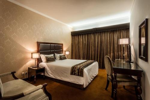 Hotel Vip Grand Maputoにあるベッド
