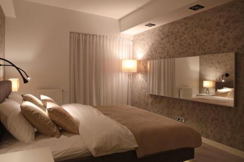 Łóżko lub łóżka w pokoju w obiekcie Super-Apartamenty VIP