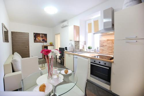 A kitchen or kitchenette at Allegro Exclusive Suites