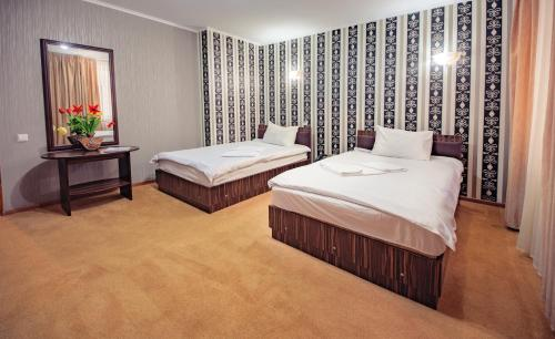 A bed or beds in a room at Europa Hotel