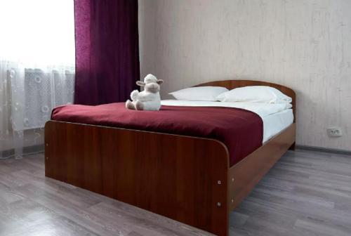 A bed or beds in a room at Квартира на Лермонтовской