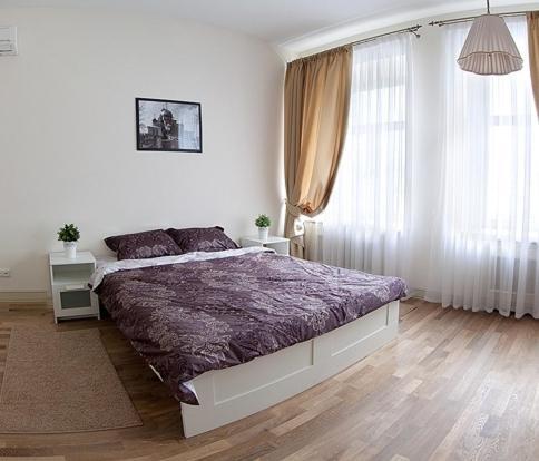 Кровать или кровати в номере Апартаменты Weekend Inn