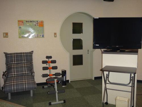 ユーティリティ ホテル クーにあるテレビまたはエンターテインメントセンター