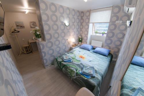 Кровать или кровати в номере Guest House Ksenia