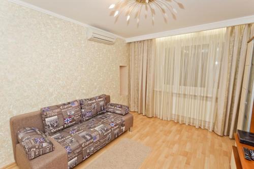 Гостиная зона в Zvezdinka 7 Apartment