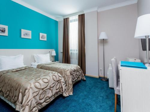 A bed or beds in a room at Aqua-Minsk Hotel