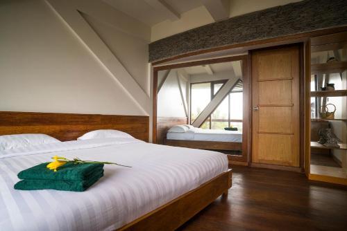 Tempat tidur dalam kamar di Pagupon Bromo Budget Lodge