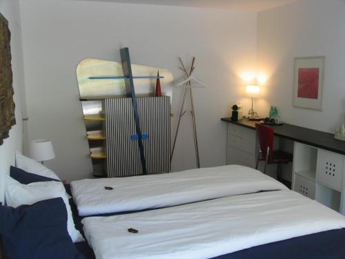 Ein Bett oder Betten in einem Zimmer der Unterkunft Gästezimmer Galmisbach
