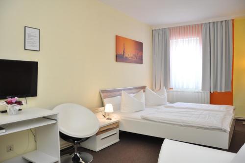 Ein Bett oder Betten in einem Zimmer der Unterkunft Hotel An der Kapelle