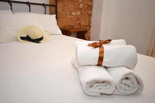 Ένα ή περισσότερα κρεβάτια σε δωμάτιο στο Ξενοδοχείο Γαλήνη