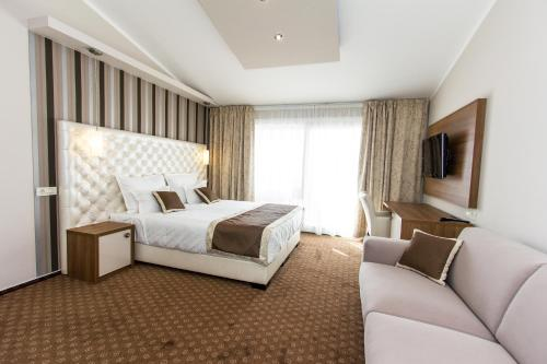 A bed or beds in a room at Rooms Nadia