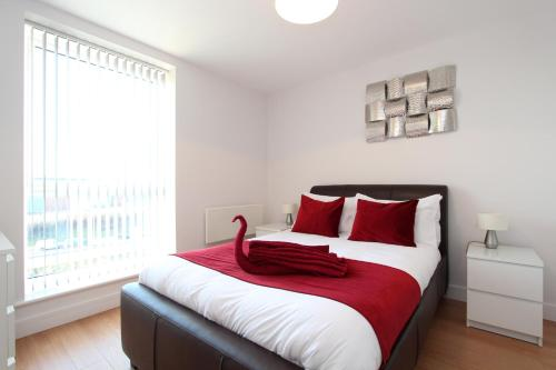 A bed or beds in a room at Skylark House Luxury Apartments