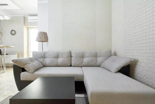 A seating area at Квартира на Островского