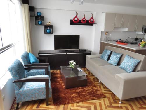 Coin salon dans l'établissement Apartamentos Quewe