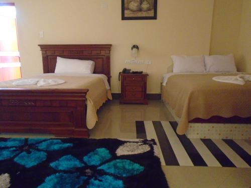 Кровать или кровати в номере Hotel Platinum Class