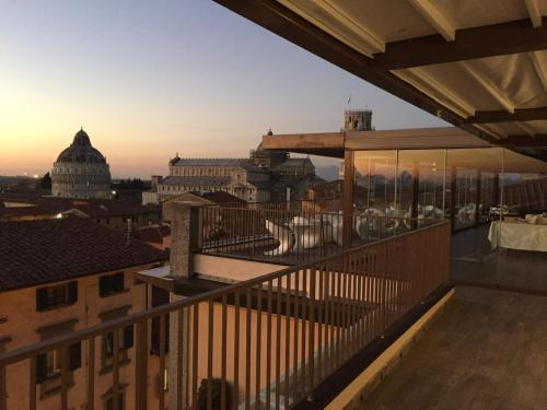 A balcony or terrace at Grand Hotel Duomo