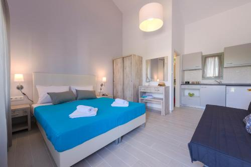 A bed or beds in a room at Terra di Olive