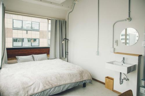 Cama ou camas em um quarto em CITAN Hostel