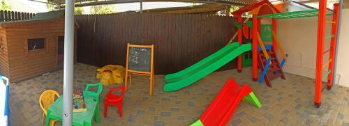Children's play area at Орхидея, семейный гостевой дом