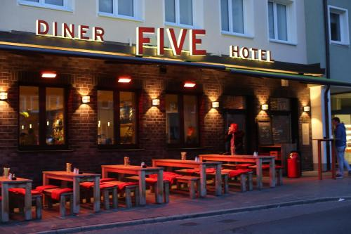 A restaurant or other place to eat at Hotel Five