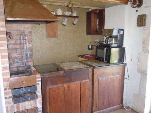 Cuisine ou kitchenette dans l'établissement La Maison du Guetteur