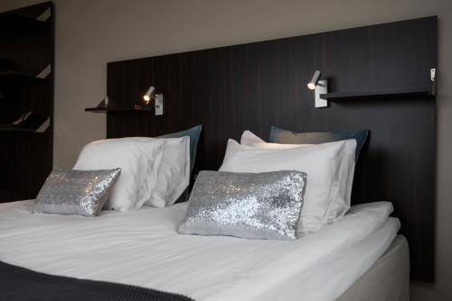 Säng eller sängar i ett rum på Hotell Fyrislund