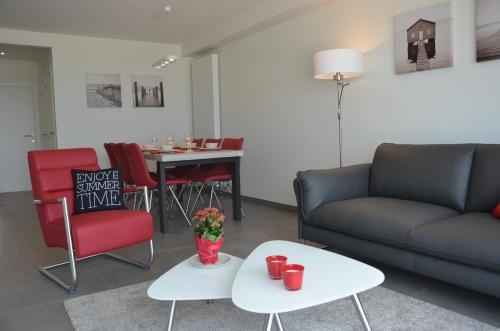 Ein Sitzbereich in der Unterkunft 4B @ Longchamp