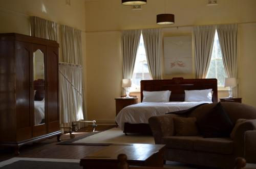 A bed or beds in a room at Old Parkes Convent