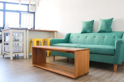 A seating area at Moment Hostel
