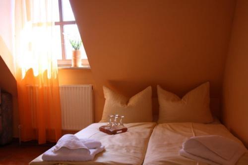 Ein Bett oder Betten in einem Zimmer der Unterkunft Holmbecks Hotel