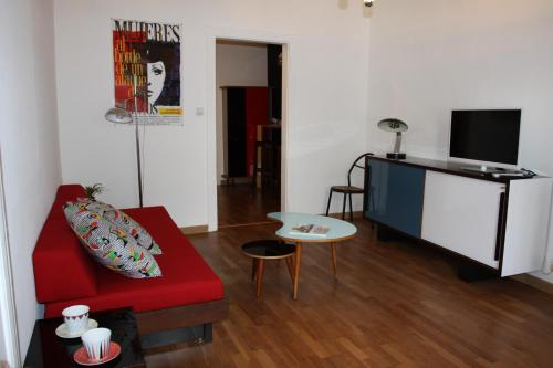 A seating area at Appartement Jeanne d'Arc