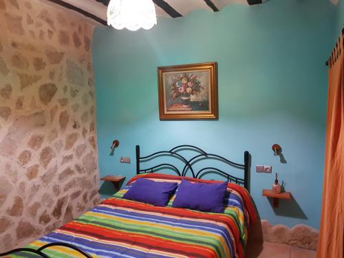 Cama o camas de una habitación en Casa Rural Valle del Cabriel