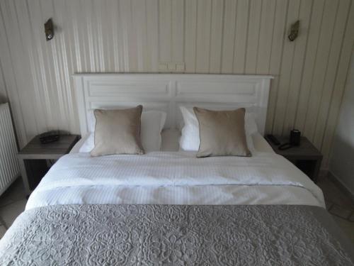 A bed or beds in a room at B&B De Polderhoeve