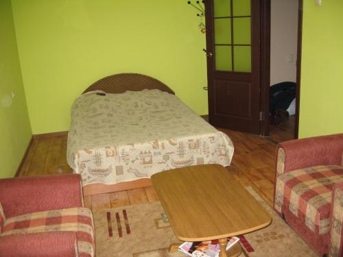 A bed or beds in a room at Apartment on Gagarina 67