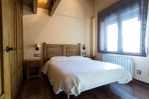 Cama o camas de una habitación en Apartaments Gran Vall