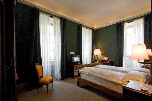 Letto o letti in una camera di Grand Hotel Della Posta