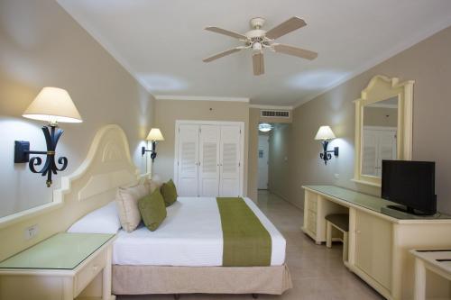 A television and/or entertainment centre at Bahia Principe Grand La Romana - All Inclusive