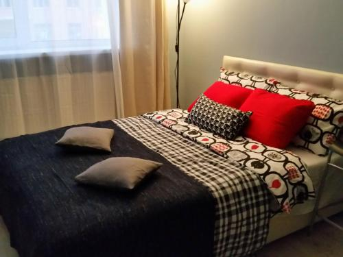 A bed or beds in a room at Apartment on Yubileyniy prospect