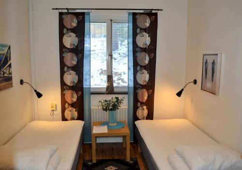 Säng eller sängar i ett rum på Södra Bergets Vandrarhem