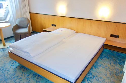 Ein Bett oder Betten in einem Zimmer der Unterkunft BTS-Hotel
