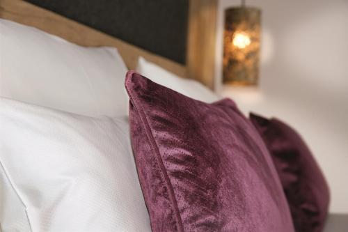 Ein Bett oder Betten in einem Zimmer der Unterkunft Sepperlwirt