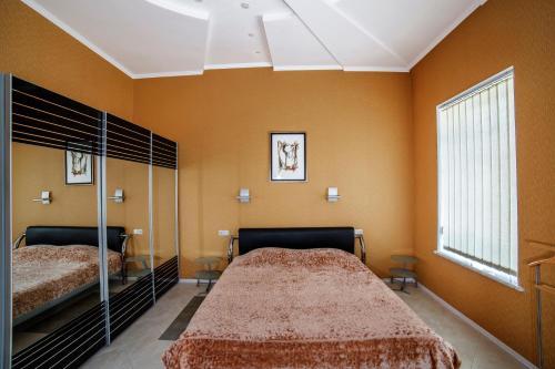 Кровать или кровати в номере Отель Виста