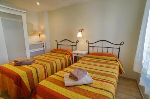 Cama o camas de una habitación en Barcelona4Seasons - Fira