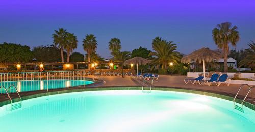 Het zwembad bij of vlak bij Bungalows Playa Limones